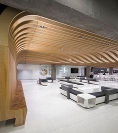 Inside the student centre at Polytechnique Montréal, is a public lounge area that has a length of seating that transforms into a sculptural wood ceiling. Design Café, Wall Design, Design Ideas, Cottage Interiors, Office Interiors, Shop Interior Design, Retail Design, Conception Paramétrique, Architecture Design