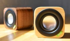 """Big sound, small package!  Wrapped in a 3"""" hand-crafted wood cube, 1Q is a powerful little Bluetooth sound system that produces warm, surprisingly natural sound."""