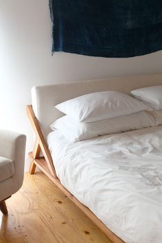 Drammen Bed - More Shop drommen wooden bed. Both architectural and comfy, master wooden bed designed by Jannis Ellenberger is a dream from every angle.
