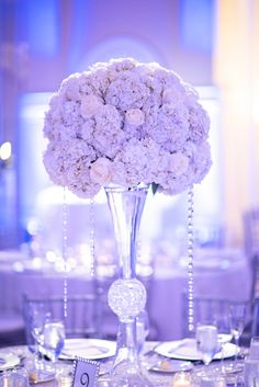 Chic Classic Silver and White Centerpiece || Photographer: Kristen Weaver Photography / Wedding Planner/Coordinator: Mia Bella Events and Design / Flowers & Decor: Terra Flowers Miami || See more: http://theeverylastdetail.com/chic-classic-silver-white-wedding/