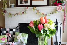 April Showers-May Flowers baby shower {Jones Design Co.}: LOVE the paper flower garland!