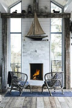 A contemporary house taken rustic is unique and perfect coastal living. Nice to see a fireplace with windows next to it. Coastal Homes, Coastal Living, Coastal Decor, Coastal Farmhouse, Coastal Cottage, Cozy Living, Interior Exterior, Interior Design, Nautical Home