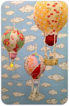 Repurposed Light Bulb Hot Air Balloon DIY, cut 8 pieces of fabric left overs in a petal shape, mod podge on, use a pop lid for the basket and yarn to hang it, <3 this