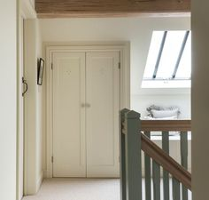 Border Oak - Show House - fitted cupboards on the landing.