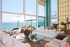 Check out spectacular New York loft on Malibu Road. Dramatic two story walls of glass opening to large deck with spa. There are two bedrooms and private balconies, to know more about this house visit http://malibuliving.org/idx/mls-14766345-25274_malibu_road_malibu_ca_90265