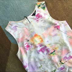 "Floral Peplum Top Gorgeous pastel watercolor print peplum top. Higher in front, lower in back. Bodice has darts that fit to your bust, then looser fit around the waist and low back. Exposed gunmetal zipper. In perfect condition. Flat measurements: bust 16.5"", arm opening 7.5"" long, front length 22"", back length 25"".  Chosen as 'Jet-Set Style' HP 3/22. H&M Tops Tank Tops"