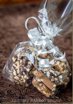Buttery Toffee, generously layered with Dark Chocolate & Sprinkled with Almonds. by LetTheBakingBeginBlog.com