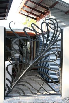 Love this lovely iron gate! Visit our site stonecountyironworks.com for more beautiful wrought iron designs!