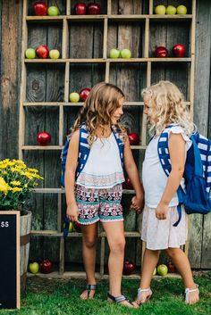 """The perfect backdrop made by placing apples on a vintage wood stand made for cute """"first day of school"""" pictures at the back to school party!"""
