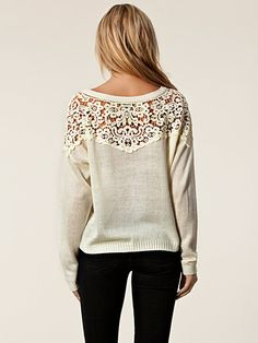 Could probably panel in the lace to an old sweater. Site is clothing company