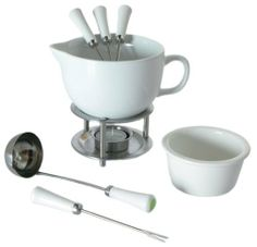 Orka Deluxe 10-Piece Sauceboat Set with Recipes by ORKA. $29.81. Includes 1 tea light, 4 fondue forks. Includes 1 serving ladel, 1 ramekin. Keeps sauces,gravy,fondue warm. Includes recipe booklet. Includes ceramic sauce boat and steel warming stand. Deluxe sauce boat