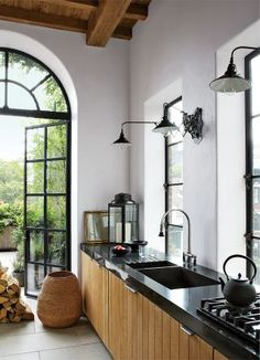 Rustic Kitchen by Alfredo Paredes and Michael Neumann Architecture in New York, New York