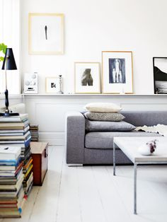 sofa shelf styling | art filled living room with clean lined couch