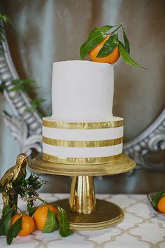 white and gold wedding cake, photo by Our Labor of Love by Heidi http://ruffledblog.com/gilded-winter-romance #weddingcake #cakes #whiteandgold