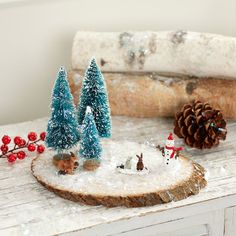 Bring the magic of a fairy garden to your holiday decor when you create this easy to make Merry Miniatures Woodland Scene