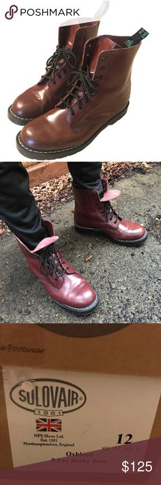 Solovair (Docs) Men's 13 Oxblood 8-Eye Derby Boots These beautiful Size US 13, high-shine derby boots are dark red / oxblood, and were handmade in England at the Dr. Martens NPS factory. The soles are oil-resistant rubber and show no wear. The uppers have minor creasing and a few small scuffs. The inners are in good condition and the gold lettering is still visible. These boots feature the suspension sole, have gray perimeter stiching & Goodyear welt construction. Not very worn so you will…
