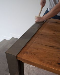 Installation of wood and metal table.