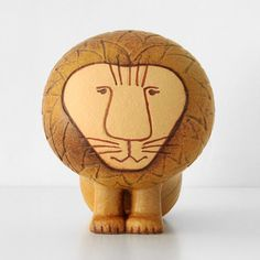 Lisa Larson Lions: I'm dying to own a collection of Lisa Larson's ceramic animals... starting with this lion.