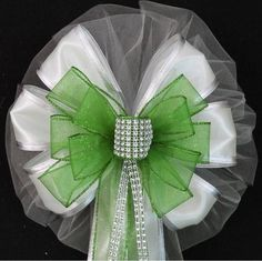 "This lime green bling wedding is a great color church bow to accent a summer wedding color theme. Add some sparkle to your wedding decoration will this bling bow. Bow Details: - 8 loops of 6"" white tu"