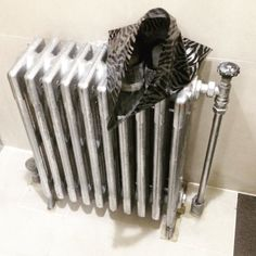 Possible art installation in Gangnam Bus Station toilets. Silver trailers in silver bag on silver radiator. #seoul #art #publicart #서울 #한국 #korea #southkorea #asia