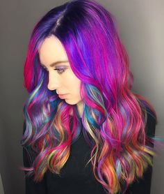 """Candyland  My model for the @kenraprofessional Neon Hair Battle. She sat in my chair with faded blue and green and 7 hours later, here's the final look! #neonmania #neonhairbattle ! • • I applied a mixture of Charcoal/Violet/Blue on her base. Then using a colormelt technique, I applied the following colors in 1-2"""" sections. •Teal •Magenta + Pink •Neon Fuchsia •Neon Green •Neon Blue •Neon Violet + Neon Blue + Neon Magenta"""