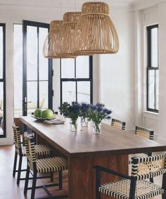 great beach house lighting...and great chairs, a nice way to create a slightly more modern look to your cottage!