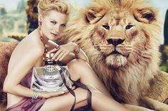 Kirsten Dunst Poses With a Lion in Bulgari Mon Jasmin Noir Fragrance