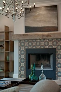 salvaged wood mantel + pattern tile fireplace by Buckingham. A great installation idea for our Tabarka, terracotta, decorative tile! Fireplace Tile Surround, Fireplace Redo, Fireplace Remodel, Fireplace Surrounds, Fireplace Design, Tiled Fireplace, Fireplace Ideas, Fireplace Makeovers, Bedroom Fireplace