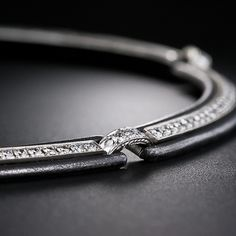 Marsh & Co. - This striking and dramatic mid-twentieth century necklace is comprised of five repeating sections composed of Marsh's signature blackened steel, combined with sparkling white full-cut diamonds set in 18 karat white gold. The blackened steel shows some blooming on the edges which, under the circumstances, can be equated with a time-worn patina and lends the effect of shimmering highlights. A very chic, collectable and wearable jewel. 15 inches; 163 diamonds = 5.00 carats total.