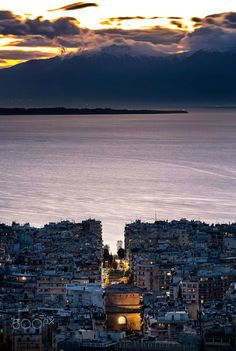 The city of Thessaloniki at dusk - In Macedonia, northern Greece, Mt Olympus in the background. Photography by Konstantinos Tls. Greek Beauty, Hotels, Greece Travel, Greek Islands, Strand, Places To See, Cool Pictures, Tourism, Beautiful Places