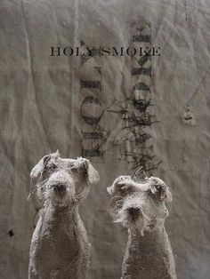 UK-based artist Helen Thompson aka Holy Smoke creates these expressive canines from wire, natural.