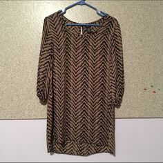 Zig Zag Dress/Shirt I wore this a couple times but is still in great condition. I wore it as a shirt and tucked it in because I am too tall to wear it as a dress but it might fit the right person as a dress or however you would like to wear it! Rue 21 Dresses Mini