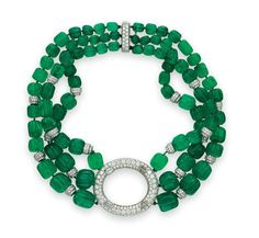 From the Estate of Carroll Petrie. A diamond and emerald necklace, by David Webb