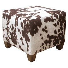 Can't resist a little touch of cowhide! Handmade ottoman with cow-print upholstery and exposed wood legs. Product: Ottoman Construction Material: Wood and fabricColor: Brown and white Features: Handmade the USA Dimensions: H x W x D Fabric Ottoman, Upholstered Ottoman, Pouf Ottoman, Cowhide Ottoman, Cowhide Decor, Cowhide Furniture, Ottoman Furniture, Accent Furniture, Refurbishing Furniture