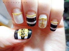 Black and white sailor nail design with golden beads