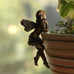 """Fairy Pot Sitters ~ very cute!  set of 4 - $24.95  Fairies are posed in 4 different positions, range in height from 3.5"""" - 3.75"""" &  are made of polystone with a bronze-like finish. The Fairies are at home on the edge of a flower pot, lampshade. Or, use your imagination."""