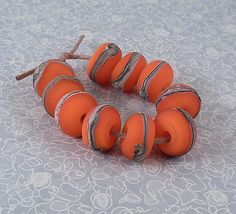 Silvered Ivory on Orange  Lampwork Accent Beads  by tanyamcguire