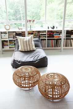 Franco Albini rattan accent piece- love mine. I put a round piece of glass on top, makes for a great side table.