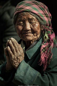Belief in tibet - A devout old woman in tibet.