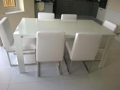Cosmopolitan white glass extendable dining table with 2 extensions of Dining chairs are Beverly in white. Delivered to our client in Surrey. Leather Bed, Extendable Dining Table, Surrey, Sofa Design, Cosmopolitan, Modern Bedroom, Contemporary Furniture, Steel Frame, Sideboard