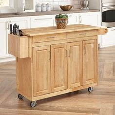 Home Styles Brown Wood Base with Wood Top Kitchen Cart x x at Lowe's. Home Styles Wood Top Kitchen Cart w/Breakfast Bar features a solid wood construction in a natural finish. Other features include three separate storage Portable Kitchen Island, Scandinavian Kitchen, Island With Seating, Portable Kitchen, Kitchen Island With Seating, Kitchen Styling, Kitchen Tops, Home Styles, Kitchen Dining Furniture