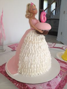 - Chocolate Barbie cake, decorated with fondant, and buttercream frosting.