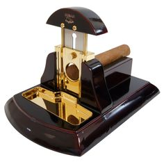 Desk cigar cutter Mesa Exotica has a high gloss black wood body and handle, and gold blade mechanism and tray so that it not only works perfectly but looks great - CUBAN CRAFTERS Top Cigars, Cigars And Whiskey, Pipes And Cigars, Cuban Cigars, Metal Cutter, Cigar Cutter, Cuban Crafters, Cigar Art, Cigar Humidor