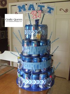 My first beer can cake!  These are full beers with 12 different shots also =)