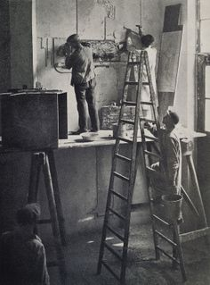 """Oskar Schlemmer's contribution of a mural as part of the redecoration of the Jugendstil premises in the spirit of the Bauhaus, (1923). Schlemmer chose the worksop wing as the location for his mural contribution for the Bauhaus exhibition of 1923, where he combined painting and sculpture in """"colored mortar reliefs"""". These were executed by master craftsman Josef Hartwig and a number of students."""