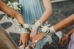 White rose wrist corsages | Photography by http://www.haydnrydings.co.uk/