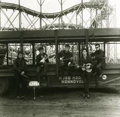 Astrid Kirchherr's first group photo of The Beatles taken at the Hamburg fairground, just blocks away from the Reeperbahn district where the group played nightly. Pete Best, George Harrison, John Lennon, Paul McCartney Stuart Sutcliffe. Hamburg, Germany 1960. Paul will be 75 in June of 2015.