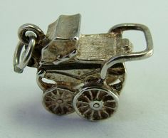 Silver Opening Nuvo Pram Charm with Baby Inside  sold for $34.73