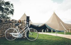 Kim & Mark's rustic, DIY unique Bicycle themed Derbyshire Tipi Wedding captured by Tipi Wedding, Derbyshire, Sidewalk, September, Bicycle, Rustic, Unique, Summer, Diy