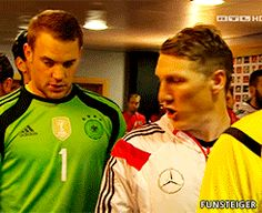 Manu and Basti talking to each other before the game against Scotland